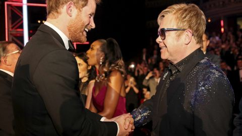 Britain's Prince Harry (L) greets British musician Elton John (R) at the Royal Variety Performance at the Royal Albert Hall in London on November 13, 2015. AFP PHOTO / POOL / PAUL HACKETT        (Photo credit should read PAUL HACKETT/AFP/Getty Images)