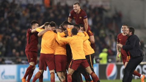 AS Roma players celebrate at the end of the Champions League quarterfinal second leg soccer match between Roma and FC Barcelona at Rome's Olympic Stadium on Tuesday.