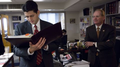 Ryan and US Rep. Jim McCrery review materials in 2005 before a news conference.