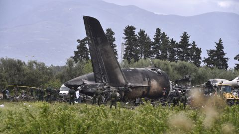 TOPSHOT - Rescuers are seen around the wreckage of an Algerian army plane which crashed near the Boufarik airbase from where the plane had taken off on April 11, 2018. The Algerian military plane crashed and caught fire killing 257 people, mostly army personnel and members of their families, officials said. / AFP PHOTO / Ryad KRAMDI        (Photo credit should read RYAD KRAMDI/AFP/Getty Images)