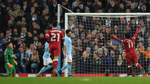 Liverpool's Roberto Firmino -- out of frame -- scores his team's second goal during the Champions League quarter-final second leg.