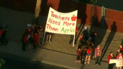 AZ: WALKOUT-TEACHERS WEAR RED, PROTEST LOW WAGES - ARIZONA