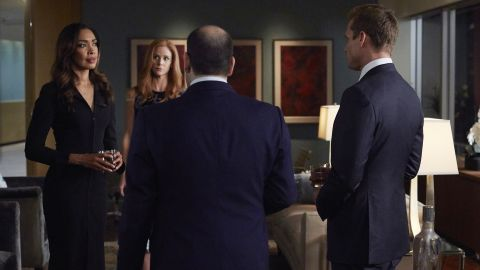 """Gina Torres as Jessica Pearson, Sarah Rafferty as Donna Paulsen, and Gabriel Macht as Harvey Specter in """"Suits."""""""