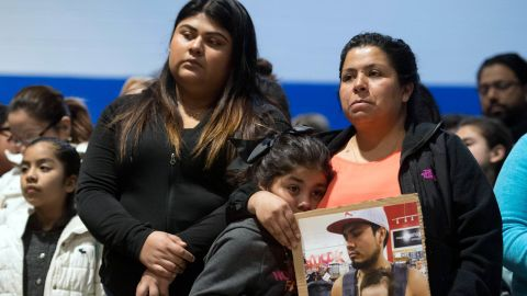 April 9, 2018; Morristown, TN, USA; Esmeralda Baustista holds a photograph of her brother Luis Bautista-Martinez, who was one of the workers detained when ICE raided Southeastern Provisions, a cattle slaughterhouse in Grainger County. With Bautista is daughter Yemaya and friend Yaqueline Cruz. The three attended a prayer vigil at Hillcrest Elementary School in Morristown, TN held in response to the raid. Mandatory Credit: Saul Young/Knoxville News Sentinel via USA TODAY NETWORK/Sipa US