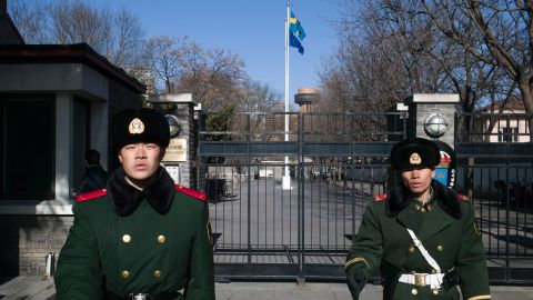 Paramilitary guards stand in front of the gates of Sweden's embassy in Beijing.