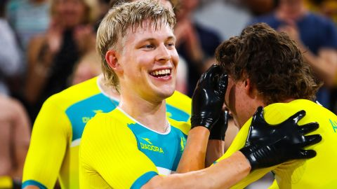 Australia's Alex Porter (C) celebrates victory with teammate Sam Welsford (R) following the Men's cycling 4000m Team Pursuit Final at the 2018 Gold Coast Commonwealth Games at the Anna Meares Velodrome in Brisbane on April 5, 2018.  / AFP PHOTO / Patrick HAMILTON        (Photo credit should read PATRICK HAMILTON/AFP/Getty Images)