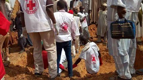 Nigerian Red Cross officials prepare a mass grave in Anka town in Zamfara, Nigeria.