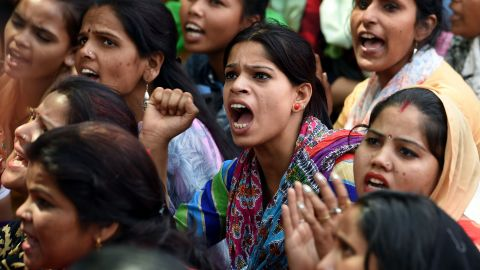 Indian women sit during a protest organised by 'Delhi Commission for Women' in New Delhi on April 13, 2018, outside Raj Ghat, memorial for Indian independence icon Mahatama Gandhi. The brutal gang rape and murder of an eight-year-old girl in India has triggered nationwide outrage, inflamed communal tensions and shone a fresh critical light on the prevalence of sexual crimes. / AFP PHOTO / MONEY SHARMA        (Photo credit should read MONEY SHARMA/AFP/Getty Images)