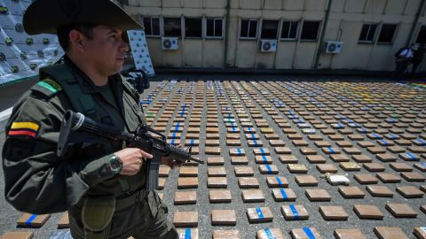 A member of the Colombian antinarcotics police, stands guard beside a one-ton shipment of cocaine seized to the country's biggest drug gang, the Gulf Clan in a container with destination to Europe in Buenaventura, Colombia's main port on the Pacific Ocean, on August 10, 2017.   / AFP PHOTO / Raul Arboleda        (Photo credit should read RAUL ARBOLEDA/AFP/Getty Images)