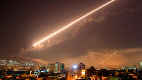 Damascus skies erupt with surface to air missile fire as the U.S. launches an attack on Syria targeting different parts of the Syrian capital Damascus, Syria, early Saturday, April 14, 2018. Syria's capital has been rocked by loud explosions that lit up the sky with heavy smoke as U.S. President Donald Trump announced airstrikes in retaliation for the country's alleged use of chemical weapons. (AP Photo/Hassan Ammar)