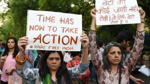 Indian demonstrators hold placards during a silent protest 'Not In My Name' in support of rape victims following high profile cases in Jammu and Kashmir and Uttar Pradesh states, in New Delhi on April 15, 2018. Indian police have made another arrest after the alleged rape of a teenager by a ruling party politician sparked protests across the country, federal investigators said April 15.  / AFP PHOTO / Sajjad HUSSAIN        (Photo credit should read SAJJAD HUSSAIN/AFP/Getty Images)
