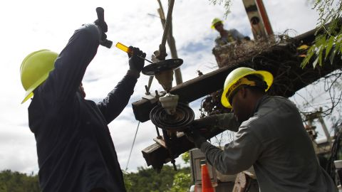 A Puerto Rico Electric and Power Authority brigade work in a remote off-road location to repair a downed power transmission line in Ponce, Puerto Rico on November 29, 2017. / AFP PHOTO / Ricardo ARDUENGO / TO GO WITH AFP STORY By Leila MACOR, US-PuertoRico-power-weather-reconstruction-hurricane        (Photo credit should read RICARDO ARDUENGO/AFP/Getty Images)