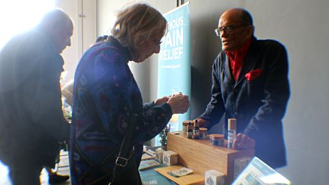 Donald Wright, who describes himself as the senior brand ambassador for a cannabis product, explains it to some of the seniors.