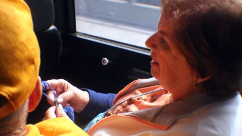 Anne Lustig knits as she rides with her husband to the marijuana dispensary.