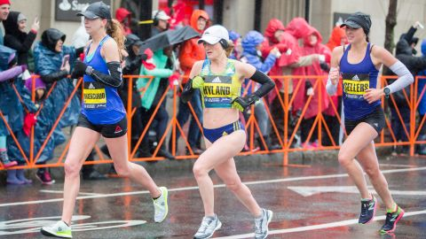 BROOKLINE, MA - APRIL 16:  Nicole Dimercurio, from left, Rachel Hyland and Sarah Sellers approach the 24 mile marker of the 2018 Boston Marathon on April 16, 2018 in Brookline, Massachusetts.  (Photo by Scott Eisen/Getty Images)