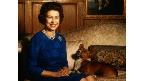 Queen Elizabeth II pictured with one of her pet corgis in 1970.