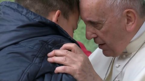"""On Sunday (April 15) Pope Francis comforted a child who lost his father during a visit to a poor district of Rome, saying God has a """"dad's heart"""". During a meeting Francis answered questions from children and one of them, Emanuele, was too shy to speak at the microphone so the pontiff decided to invite him onto stage. The child started crying and hugged Francis and whispered his question into the pope's ears, saying he was afraid that his father, who was an atheist, could not go to heaven. Francis comforted Emanuele and said that it is God who decides who goes to heaven and that, since God has a 'dad's heart', he will not abandon the boy's dad, even if he was not a believer. The leader of the world's 1.2 billion Catholics visited the parish of St. Paul of the Cross in Rome's Corviale neighbourhood and met with children of the poor district of the Italian capital and celebrated Mass for the parish community."""