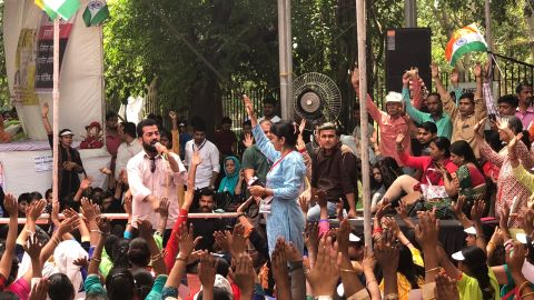 A women's rights activist addresses a rally of hundreds of Maliwal's supporters.