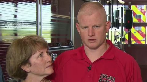 Andrew Needum speaks Thursday at a news conference with his mother at his side.
