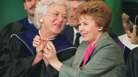 Raisa Gorbachev (R), wife of Soviet President Mikhail Gorbachev, raises the hands of Barbara Bush (L), wife of US President George Bush 01 June 1990 while the two were introduced at the Wellesley graduation ceremony in Wellesley, Mass. Raisa Gorbachev died 20 Septembre 1999 in Muenster, Germany, after a lengthy struggle with leukemia.  / AFP / DON EMMERT        (Photo credit should read DON EMMERT/AFP/Getty Images)