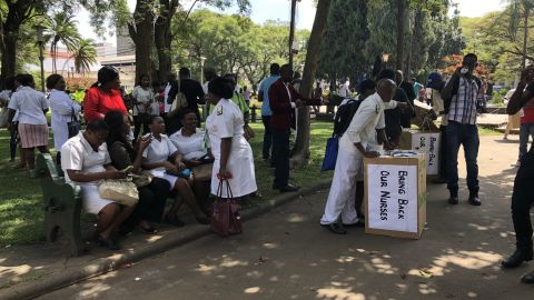 Nurses attending to the public at the Africa Unity Square in Harare,  Zimbabwe's capital Friday.