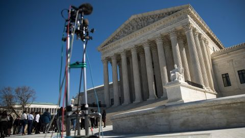People gather outside the Supreme Court during oral arguments in the U.S. v. Micosoft case February 27, 2018 in Washington, DC.