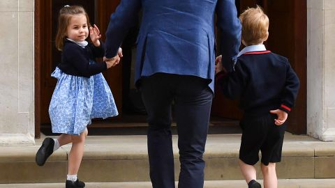 """Charlotte turns to wave at journalists as she arrives with her father and her brother George to meet the <a href=""""https://edition.cnn.com/interactive/2018/04/world/royal-baby-cnnphotos/index.html"""" target=""""_blank"""">newest member of their family</a>, her brother Prince Louis, in April 2018."""