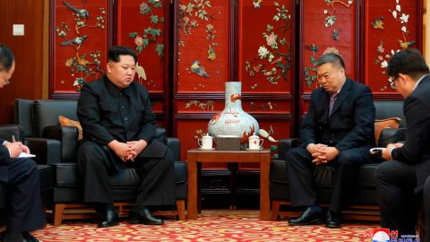 In this photo provided  by the North Korean government, North Korean leader Kim Jong Un, left, meets China's ambassador to North Korea Li Jinjun at the the Chinese Embassy in Pyongyang following Sunday's traffic accident.