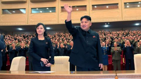 An undated photo published by North Korean state media in May 2013 shows Ri alongside Kim at a performance in Pyongyang.