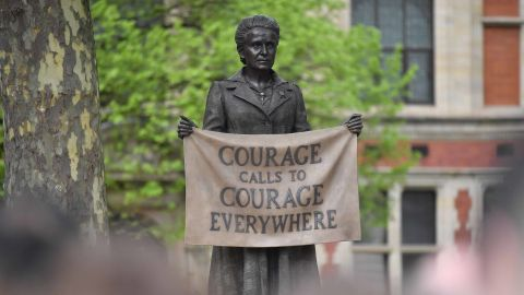 A statue of suffragist and women's rights campaigner Millicent Fawcett by British artist Gillian Wearing is unveiled in Parliament Square in London on April 24, 2018. - The first statue of a woman on Parliament Square in London was to be unveiled on April 24 to celebrate the 100th anniversary of women winning the right to vote in Britain. The statue of women's rights campaigner Millicent Fawcett will stand alongside those of 11 men, including Britain's wartime leader Winston Churchill, Indian independence icon Mahatma Gandhi and anti-apartheid leader Nelson Mandela. (Photo by Ben STANSALL / AFP)        (Photo credit should read BEN STANSALL/AFP/Getty Images)