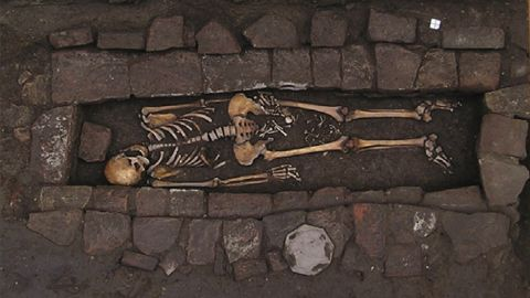 """The skeleton of a young woman and her fetus were found in a brick coffin dated to medieval Italy. Her skull shows an example of neurosurgery, and her child was extruded after death in a rare """"coffin birth."""""""