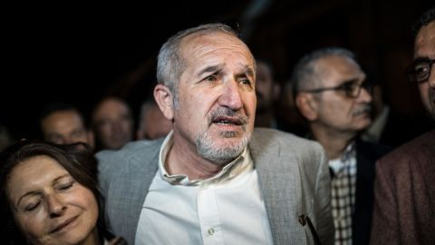 Cumhuriyet chairman Akin Atalay (R) and his wife Adalet Atalay speak to journalists after being released from Silivri prison on April 26, 2018.