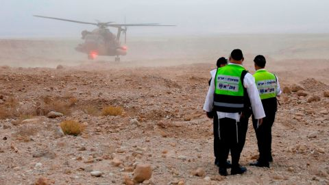Israeli rescue services search for the teens Thursday after flash floods swept through the area.