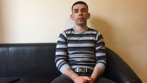 Abdul Bari sits in a refugee shelter in Manchester, where he survives on just $48 a week.