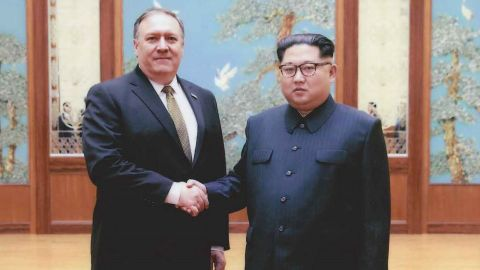 Mike Pompeo shakes hands with North Korean leader Kim Jong Un in Pyongyang in a photo provided by the White House.