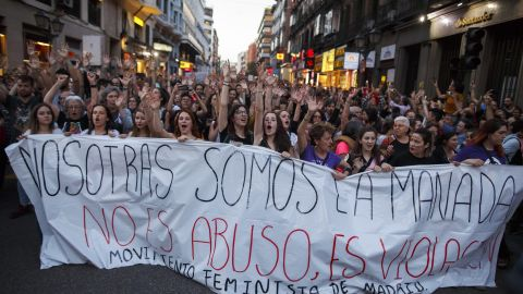 """Protesters carry a banner through Madrid reading 'We are the wolf pack. It not abuse, it is rape"""" during a demonstration in 2018."""