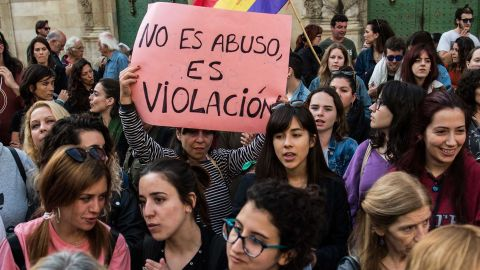 """ALICANTE, SPAIN - 2018/04/26: A woman with a placard that reads: """"it is not abuse, it is rape"""" protesting against the judicial verdict of """"La Manada"""" case. The Court of Navarra has sentence 9 years of prison to five men for sexual abuse instead of rape. The gang (known as """"La Manada"""") assaulted a woman, 18 years old, in Pamplona, during the San Fermin Festival in 2016. (Photo by Marcos del Mazo/LightRocket via Getty Images)"""