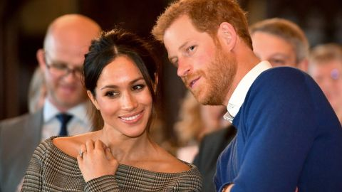Prince Harry whispers to Meghan Markle as they watch a dance performance in Cardiff, Wales, in January.
