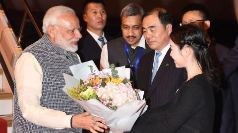 Indian Prime Minister Narendra Modi receives flowers after arriving in China's central Hubei province on April 27.