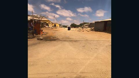 A woman walks along a street in the Somalian port city of Kismayo.