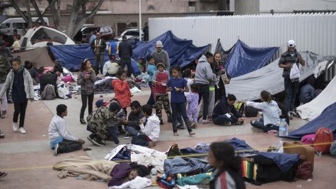 Migrants wait for access to request asylum in the US, at the El Chaparral port of Entry in Tijuana, Mexico, Monday, April 30, 2018. bout 200 people in a caravan of Central American asylum seekers waited on the Mexican border with San Diego for a second straight day on Monday to turn themselves in to U.S. border inspectors, who said the nation's busiest crossing facility did not have enough space to accommodate them. (AP Photo/Hans-Maximo Musielik)