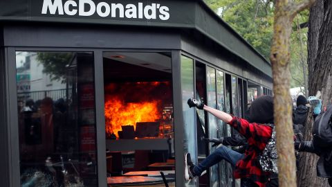 A McDonald's restaurant is hit with petrol bombs thrown by during the traditional May Day rally in the center of Paris.