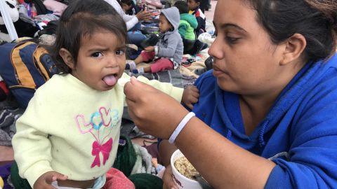 Catherine Enamorado feeds her daughter Ashly.