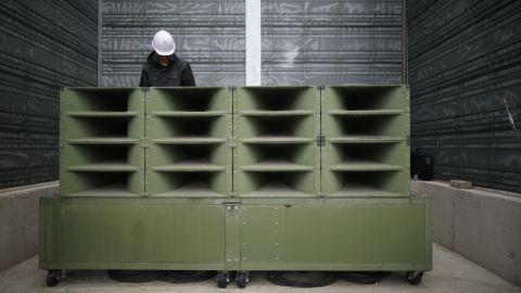 A worker dismantles the loudspeakers.