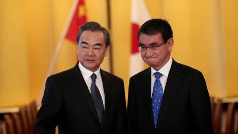 Japan's Foreign Minister Taro Kono (R) poses with his Chinese counterpart Wang Yi (L) at the start of their meeting in Tokyo on April 15.