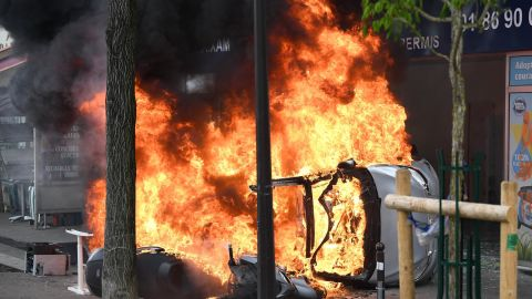 Vehicles burning as thousands of people take to the streets during the May Day demonstrations in Paris.