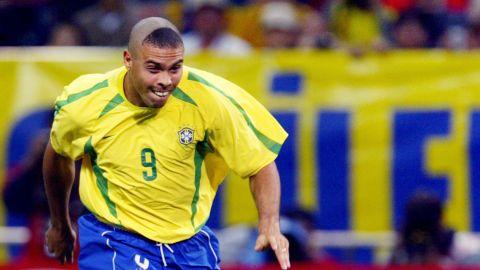 SAITAMA, JAPAN:  Brazil's forward Ronaldo kicks the ball to scores the first  goal against Turkey during the semi-final match of the FIFA 2002 World Cup Korea Japan 26 June, 2002, in Saitama, Japan.