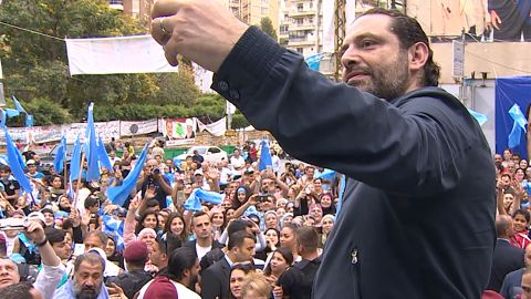Prime Minister Saad Hariri takes a selfie with supporters.