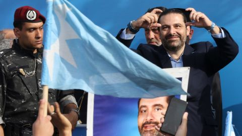 Prime Minister Saad Hariri gestures on stage during a campaign rally in Sidon, Lebanon.