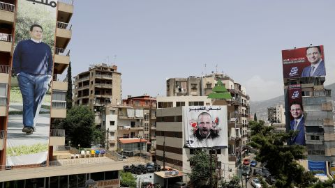 Posters of candidates for the upcoming Lebanese parliamentary elections hang on buildings in northern Beirut.